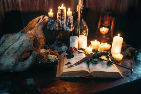 99438119-witchcraft-dark-magic-candles-with-ritual-book